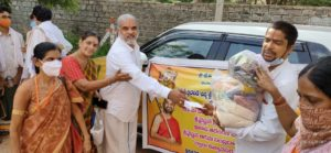 Distributing privisions to 450 brahmin families 1