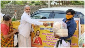 Distributing privisions to 450 brahmin families