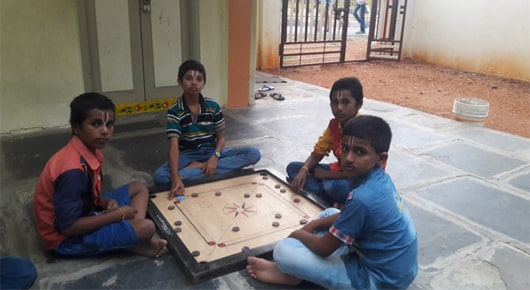 Make a Donation Orphanage Children Playing Caroms